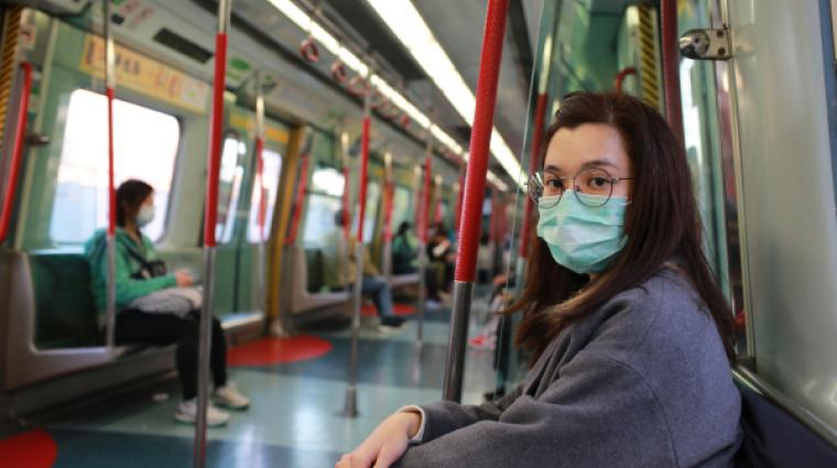 Asian girl in metro wearing face mask