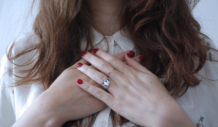 Woman holding hands in front of heart